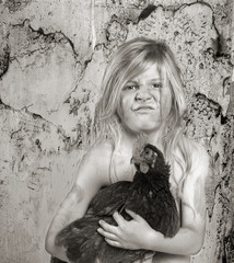 Dirty Child holding a chicken-1