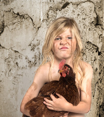 Dirty Child holding a chicken-2