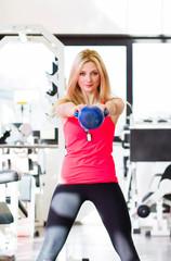 Fitness woman using kettlebell
