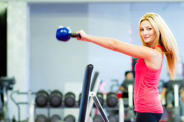 Fitness woman using kettlebell