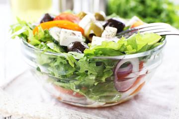 Greek salad in glass dish