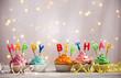 Leinwandbild Motiv Delicious birthday cupcakes on table on light background