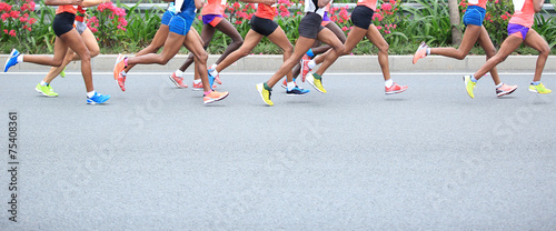 Marathon running race, people feet on city road  - 75408361