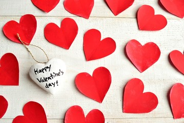 White heart Valentines day ornament on red hearts background