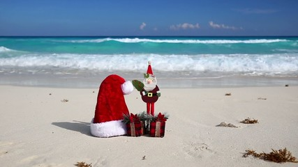 Christmas Helper Hat, Santa Claus toy and present box on caribbe
