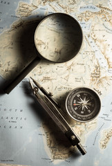 Compass with magnifier on map.