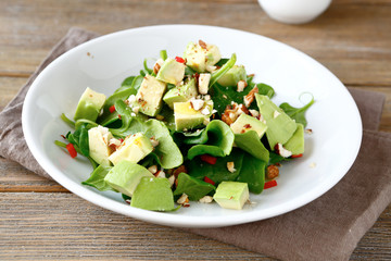 Salad with slices of avocado and spinach