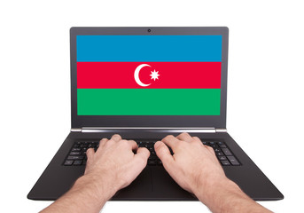 Hands working on laptop, Azerbaijan