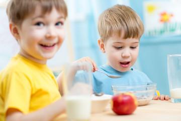 kids eating healthy food in kindergarten