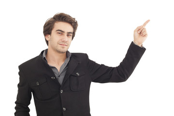 Handsome young man pointing to somewhere