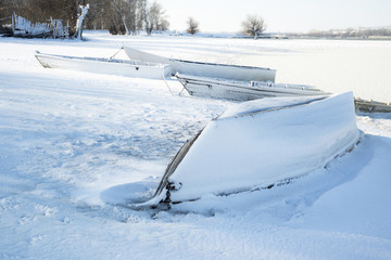 The thrown old boats on snow