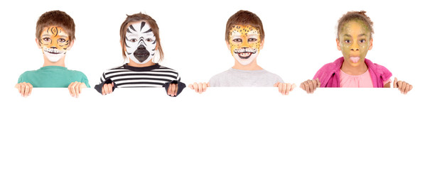 little girl with face painted as a zebra isolated in white