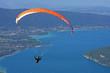 Leinwandbild Motiv paraglider over Annecy lake