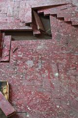 wooden parquet floor red damaged