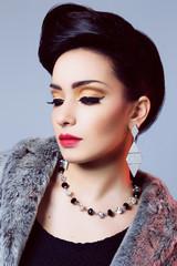 Gold makeup, fashion girl portrait