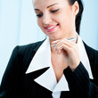 Happy smiling businesswoman with pen at office