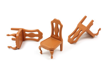 toy plastic chairs in brown on a white background