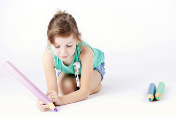 Cute little girl writing with pencil