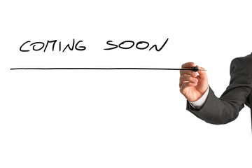 Man writing Coming soon on a virtual screen