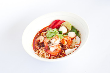 Sour prawn soup(Tom yum khoong) with noodles isolated