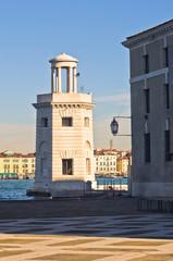 Old lighthouse in front of San Giorgio Maggiore church in Venice