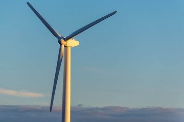 renewable energy - wind turbines against a blue sky