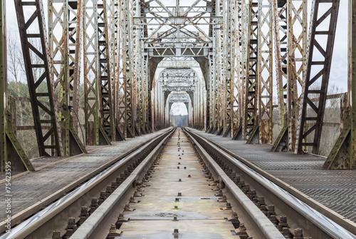 Railway trucks going through bridge
