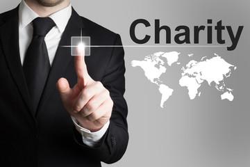 businessman pushing button charity world