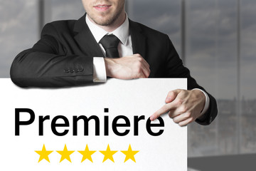 businessman pointing on sign premiere