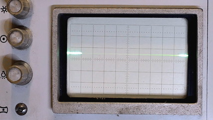Pulses and sine wave on the oscilloscope screen of the old