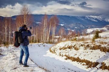 Photographer shooting landscapes