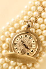 Watch on white pearl