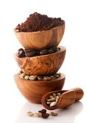 various coffee in a wooden bowl and scoop