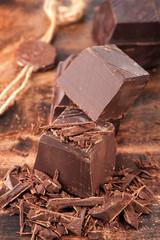 Dark chocolate on wooden background
