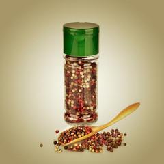 Peppercorn. Pepper in wooden spoon