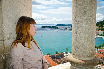 Split. View from the tower. girl looking down