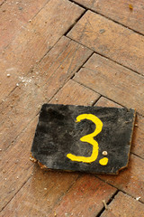 number three wooden tag