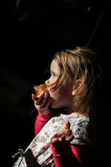 Girl eating donut oliebol