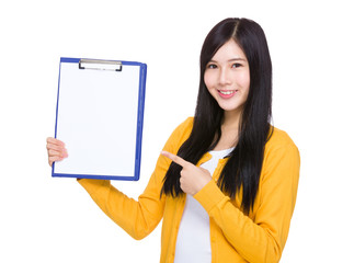 Woman finger point to clipboard