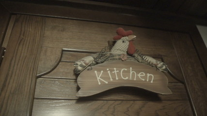 chicken decoration on the wooden door slow motion