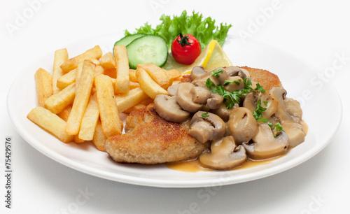 Leinwanddruck Bild Jägerschnitzel mit Pommes frites
