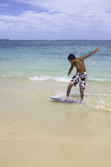 teenage boy on skim board