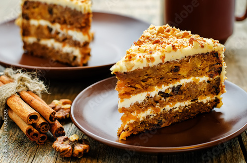 Fototapeta carrot cake with walnuts, prunes and dried apricots