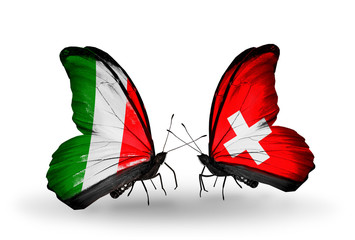 Two butterflies with flags Italy and Switzerland