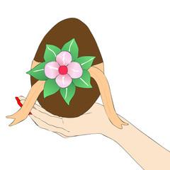 Mano di donna con Uovo di Pasqua
