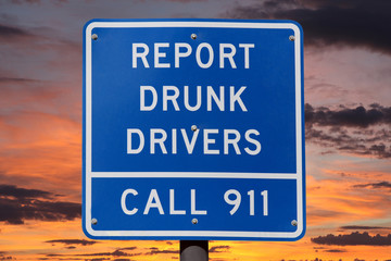 Report Drunk Drivers Sign with Sunset