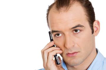 Headshot upset depressed worried young man calling mobile phone