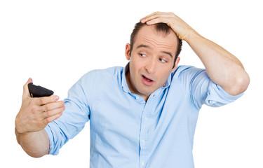 man feeling head, surprised he is losing hair, receding hairline