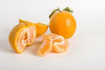 Orange segments with whole orange