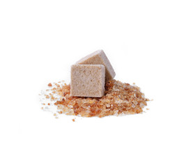 Brown cane sugar cubes  on white background